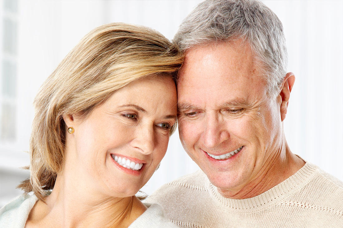 Happy couple making smart investment planning decisions